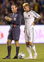 LA Galaxy midfielder David Beckham looks over the shoulder of referee Terry Vaughn booking during the Western Conference Final. The LA Galaxy defeated the Houston Dynamo 2-1 to win the MLS Western Conference Final at Home Depot Center stadium in Carson, California on Friday November 13, 2009.....