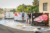 Dumpster Art Painting Day, Nov. 15, 2017 in the Haines Hall parking lot.<br /> Jim Crowder in Grounds had an inspiring idea to have the dumpsters decorated by the campus community, so these dumpsters won't be an eyesore.<br /> Grounds is partnering with Art and Art History Department, Oxy Arts, and Office of Community Engagement to make this Dumpster Art program possible!<br /> Guest artist Molly Allis and Sustainability Coordinator Jenny Low helps students paint. Fishes and coral - Melissa Gutierrez Gonzalez '21; Flowers - Danika Odell '20; and Boba - Margaret Su '18.<br /> (Photo by Marc Campos, Occidental College Photographer)