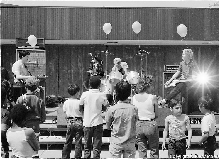 Minor Threat at Patrick Henry Elementary School Fair, Arlington VA on May 15, 1982. This was the school that the children of Don Zientara (of Inner Ear Studios) attended. Immediately following the show, the band (and photographer Rusty Moore) drove 4 hours to NYC to play another show with Bad Brains and Double-O at Club 57.