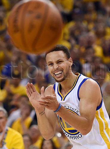 30.05.2016. Oakland, CA, USA - Golden State Warriors' Stephen Curry (30) reacts after sinking a layup against the Oklahoma City Thunder during the first quarter on Monday, May 30, 2016, at Oracle Arena in Oakland, Calif. The Warriors won 96-88  to go through to the best of 7 finals versus Cleveland.