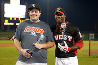 Travis Witherspoon (2) of the Cedar Rapids Kernels poses for a picture with his sponsored fan after winning the Midwest League All-Star Home Run Derby at Modern Woodmen Park on June 20, 2011 in Davenport, Iowa. (David Welker / Four Seam Images)