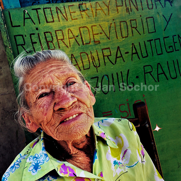 Julia Rosa Cardoña, an 88-years-old Colombian woman, poses for a picture on the street of Barrio Triste, a neighborhood in the center of Medellín, Colombia, 21 November 2016.