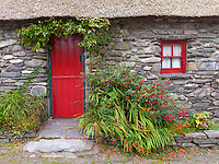County Kerry, Ireland:<br /> Stone cottage with red trim and thatched roof