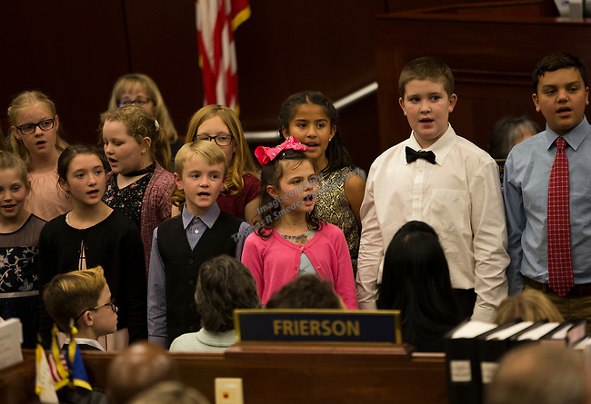 The Mark Twain Elementary School Choir sings during Nevada Governor Steve Sisolak's State of the State Address from the Assembly Chambers of the Nevada Legislature in Carson City, Nev., Wednesday, Jan. 16, 2019. (AP Photo/Tom R. Smedes)