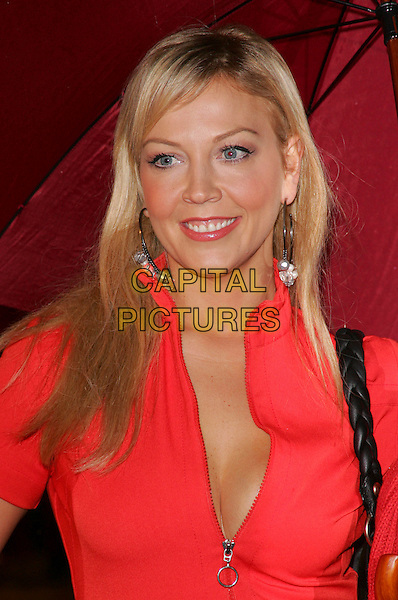 "LIZ FULLER.European Premiere of ""Fred Claus"" at the Empire Cinema, Leicester Square, London, England, November 19th 2007.half length zip low cut red top umbrella.CAP/ROS.©Steve Ross/Capital Pictures"