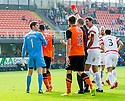 Dundee Utd's Nadir Ciftci (7) uses his hand to knock the ball into the net and earns himself a second yellow and red card.