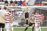Houston, TX - Friday December 11, 2016: Ian Harkes (16) of the Wake Forest Demon Deacons heads the ball towards the Stanford Cardinal goal at the NCAA Men's Soccer Finals at BBVA Compass Stadium in Houston Texas.