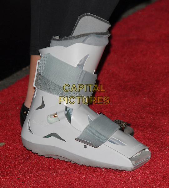 KIMBERLY STEWART'S FOOT.Attends The Drinks America Launch Party for Trump Vodka held at Les Deux in Hollywood, California, USA. .January 17th, 2007.wound foot cast broken injury grey gray shoe.CAP/DVS.©Debbie VanStory/Capital Pictures