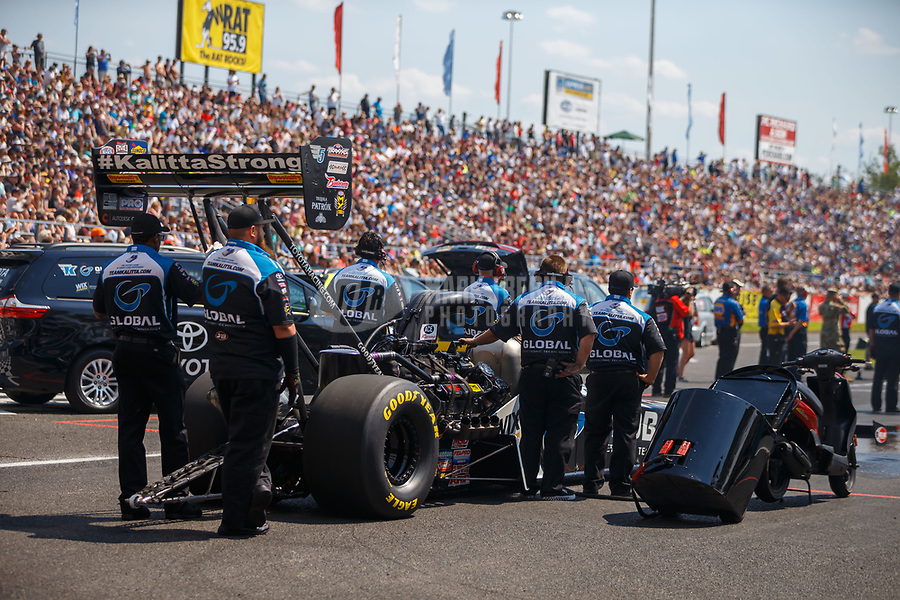 Jun 10, 2017; Englishtown , NJ, USA; Crew members with NHRA top fuel driver Shawn Langdon during qualifying for the Summernationals at Old Bridge Township Raceway Park. Mandatory Credit: Mark J. Rebilas-USA TODAY Sports