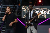 David Usher (left) and Karim Ouellet perform at the St-Jean Baptist show on the Plains of Abraham in Quebec City during the Fete nationale du Quebec, Friday June 23, 2017.