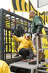 Greenpeace activists set of a climate alarm at the United Nations Climate Talks in Bonn Germany. The activists locked themselves into a cage on the back of a truck and fire crews had to use heavy equipment to cut through the bars and free them. The sound of the alarm could be heard inside the conference center as negotiators continued to stall and make very little progress.  (©Robert vanWaarden)