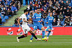 Getafe CF's Jorge Molina and Valencia CF's Ezequiel Garay during La Liga match between Getafe CF and Valencia CF at Coliseum Alfonso Perez in Getafe, Spain. November 10, 2018.