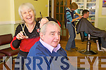 JUST A TRIM, SIR?: John O'Quigley gets a trim from Margaret Coffey, who has taken over the running of the Listowel barbers, 100 years after John's family first opened the business in the town.