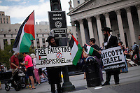 People attend a Protest Against Israeli Military Action In Gaza in New York on July 24, 2014 in New York City. The Conflict is on its Day 17 and At least 797 Palestinians have been killed and more than 5,100 wounded since the fighting began. Kena Betancur/VIEWpress