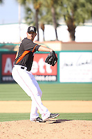 Josh Spence (48) of the Miami Marlins pitches an inning  during a Grapefruit League Spring Training game at the Roger Dean Complex on March 4, 2014 in Jupiter, Florida. Miami defeated Minnesota 3-1. (Stacy Jo Grant/Four Seam Images)