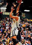 29 January 2012: University of Vermont Catamount forward Luke Apfeld, a Sophomore from Wolfeboro, NH, in action against the University of New Hampshire Wildcats at Patrick Gymnasium in Burlington, Vermont. The Catamounts defeated the Wildcats 77-60 in America East play. Mandatory Credit: Ed Wolfstein Photo