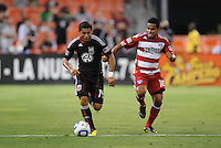 DC United midfielder Andy Najar (14)  runs with the ball follow by FC Dallas David Ferreira (10)   FC Dallas defeated DC United 3-1 at RFK Stadium, Saturday August 14, 2010.