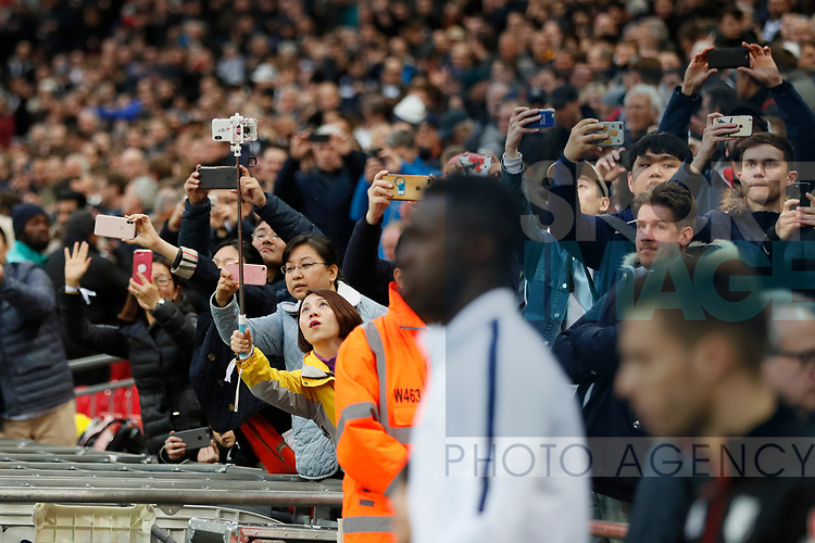 Fans take pictures with their mobile devices of the teams walking out during the premier league match at Wembley Stadium, London. Picture date 30th April 2018. Picture credit should read: David Klein/Sportimage