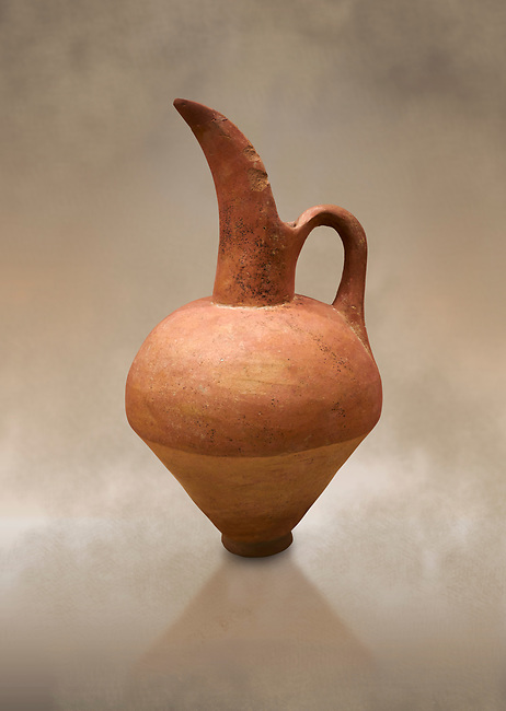 Hittite terra cotta beak spout pitcher. Hittite Old Period, 1650 - 1450 BC.  Hattusa Boğazkale. Çorum Archaeological Museum, Corum, Turkey. Against a warm art bacground.