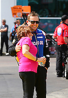 Mar 13, 2015; Gainesville, FL, USA; Charlotte Lucas (left) getting a hug from NHRA top fuel driver Richie Crampton during qualifying for the Gatornationals at Auto Plus Raceway at Gainesville. Mandatory Credit: Mark J. Rebilas-