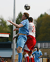 Michael Gash of York City and Michael Bostwick of Stevenage Borough contest a header during the Blue Square Premier match between Stevenage Borough and York City at the Lamex Stadium, Broadhall Way, Stevenage on Saturday 24th April, 2010..© Kevin Coleman 2010 ..