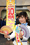 "November 27, 2017, Tokyo, Japan - A campaign girl of the lottery Akari Mizutani displays sample tickets of  the one billion yen ""Year-end Jumbo Lottery"" as the first tickets go on sale in Tokyo on Monday, November 27, 2017. Thousands punters queued up for tickets in the hope of becoming a billionaire.      (Photo by Yoshio Tsunoda/AFLO) LWX -ytd"