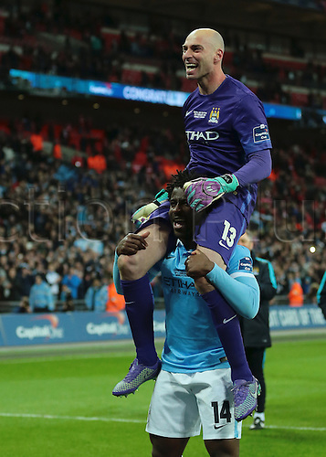 28.02.2016. Wembley Stadium, London, England. Capital One Cup Final. Manchester City versus Liverpool. Manchester City Forward Wilfried Bony carries hero of the hour Manchester City Goalkeeper Wilfredo Caballero on his shoulders