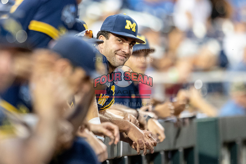 Michigan Wolverines pitcher Jack Bredeson (34) smiles during the ninth inning of Game 6 in the NCAA College World Series against the Florida State Seminoles on June 17, 2019 at TD Ameritrade Park in Omaha, Nebraska. Michigan defeated Florida State 2-0. (Andrew Woolley/Four Seam Images)