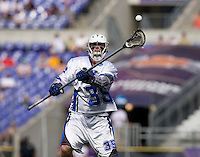 Parker McKee (35) of Duke passes the ball upfield during the NCAA Men's Lacrosse Championship held at M&T Stadium in Baltimore, MD.  Duke defeated Notre Dame, 6-5, to win the title in overtime.