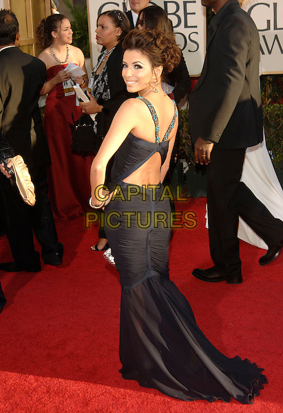 EVA LONGORIA.Red Carpet Arrivals - 64th Annual Golden Globe Awards, Beverly Hills HIlton, Beverly Hills, California, USA, January 15th 2007..globes full length black dress hand on hip turquoise beads beaded looking back over shoulder backless cut out straps.CAP/PL.©Phil Loftus/Capital Pictures