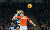 Matt Bloomfield of Wycombe Wanderers & Cameron McGeehan of Luton Town battle in the air during the Sky Bet League 2 match between Wycombe Wanderers and Luton Town at Adams Park, High Wycombe, England on 6 February 2016. Photo by Andy Rowland.