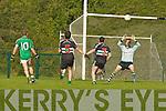 Sean O'Sulleabhain Colaiste na Sceilige chips the  Colaiste Chrois Ri goalkeeper to score a great goal  in Killarney on Wednesday