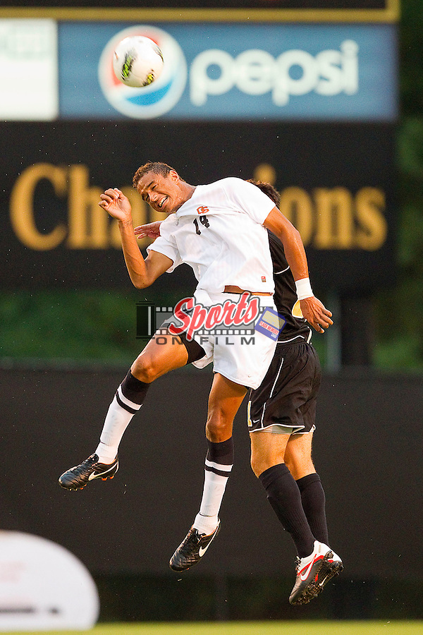 Khiry Shelton #14 of the Oregon State Beavers heads the ball away from a Wake Forest Demon Deacons defender at Spry Soccer Stadium on September 4, 2011 in Winston-Salem, North Carolina.  The Demon Deacons and the Beavers played to a 0-0 tie.  (Brian Westerholt / Sports On Film)