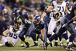 Seattle Seahawks running back Marshawn Lynch breaks through the  St. Louis Rams defensive line at CenturyLink Field in Seattle, Washington on December 12, 2011. The Seahawks beat the Rams 30-13. ©2011 Jim Bryant Photo. All Rights Reserved.