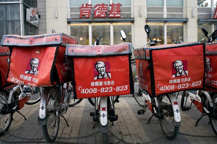 Kentucky Fried Chicken (KFC) delivery bikes stand outside a KFC in Nanjing, Jiangsu, China.