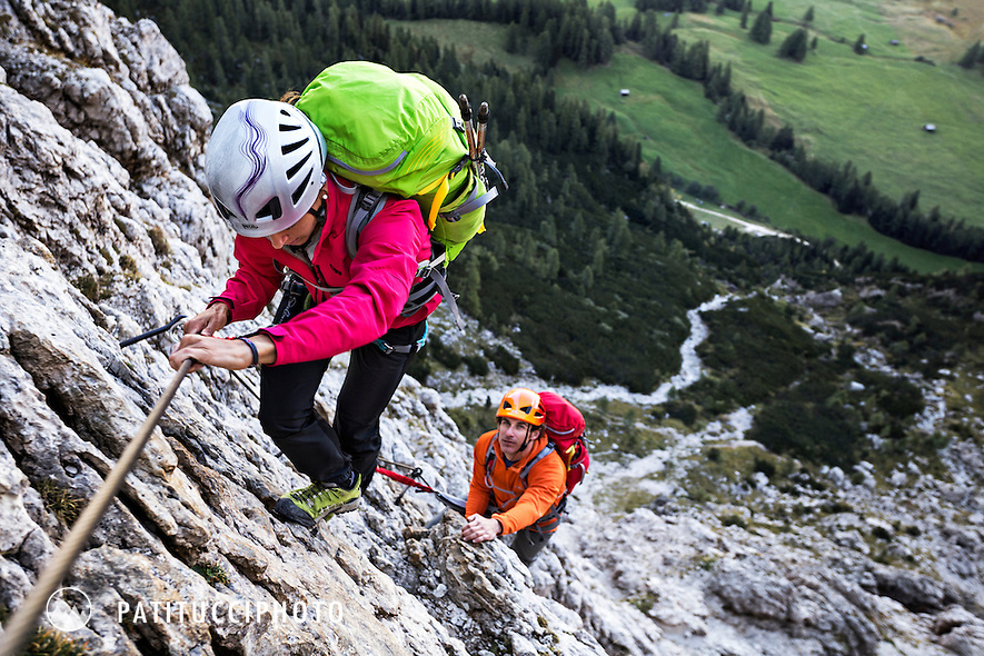Couple climbing the Dolomites Via Ferrata Tridentina while on the Alta Via 2