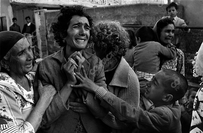 Turkish woman with son mourning the death of her husband killed by Greek militia during the civil war, Limassol, Cyprus, 1964.