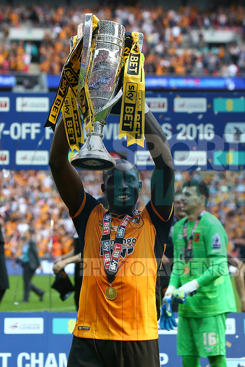 Hull?s Mohamed Diame celebrates promotion with the cup during the Skybet Championship Play Off Final match at Wembley Stadium. Photo credit should read: Philip Oldham/Sportimage