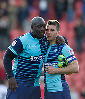 Adebayo Akinfenwa of Wycombe Wanderers with Matt Bloomfield of Wycombe Wanderers after the Sky Bet League 2 match between Leyton Orient and Wycombe Wanderers at the Matchroom Stadium, London, England on 1 April 2017. Photo by Andy Rowland.
