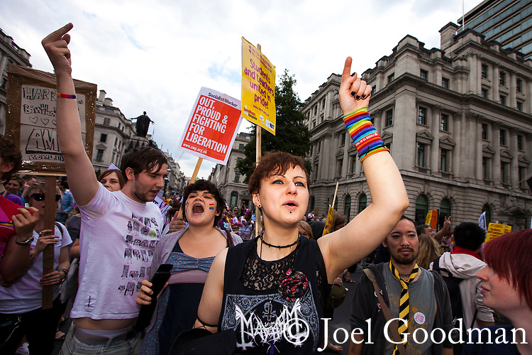 © Joel Goodman - 07973 332324 . 02/07/2011 . London , UK . People react to a protest against the march by evangelical Christians , at the march . Tens of thousands take part in the annual Pride march in London . Photo credit : Joel Goodman