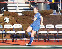 Along the side line, Boston Breakers defender Rhian Wilkinson (7) clears the ball.  In a National Women's Soccer League Elite (NWSL) match, the Boston Breakers (blue) tied the Washington Spirit (white), 1-1, at Dilboy Stadium on April 14, 2012.