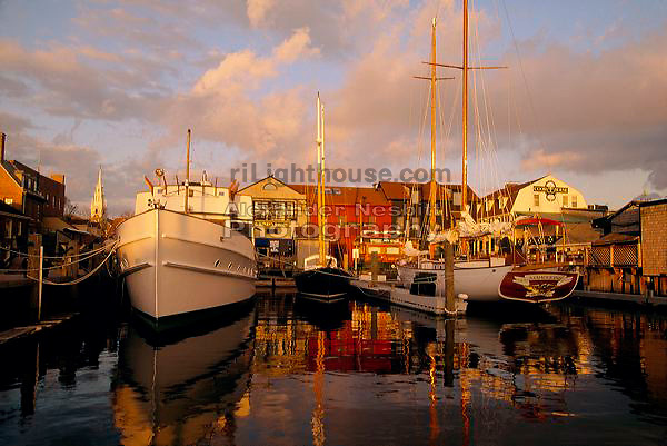 USA, Newport, RI - Boats resting at the Bowen's wharf dock in the late afternoon light...