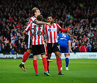 Lincoln City's Harry Anderson, centre, celebrates with team-mates Jordan Maguire-Drew, left, and Matt Green after his cross was deflected into the goal by Chesterfield's Andy Kellett for the Imps second goal<br /> <br /> Photographer Chris Vaughan/CameraSport<br /> <br /> The EFL Sky Bet League Two - Lincoln City v Chesterfield - Saturday 7th October 2017 - Sincil Bank - Lincoln<br /> <br /> World Copyright &copy; 2017 CameraSport. All rights reserved. 43 Linden Ave. Countesthorpe. Leicester. England. LE8 5PG - Tel: +44 (0) 116 277 4147 - admin@camerasport.com - www.camerasport.com