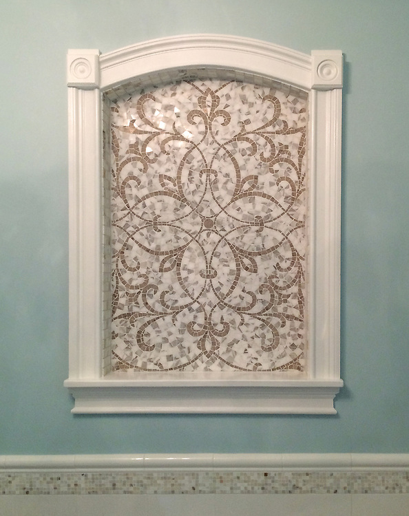 This custom Marabel mosaic niche is shown in polished Calacatta Baroque and honed Jura Grey.<br /> -photo courtesy of Stratta, The Tile Boutique<br /> <br /> For pricing samples and design help, click here: http://www.newravenna.com/showrooms/