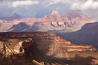 Zoroaster Temple glows in the sunlight during a November storm over the Grand Canyon.