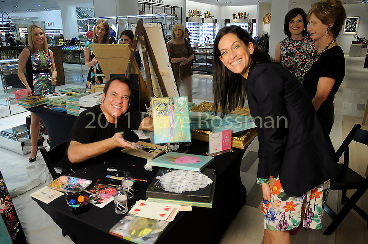 Artist Franco Mondini Ruiz and Maryam Naderi at the Saks Fifth Avenue Key to the Cure Breast Care Centers at Memorial Hermann Wednesday Oct. 26,2016.(Dave Rossman photo)