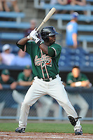 Greensboro Grasshoppers left fielder Rand Smith #14 awaits a  a pitch during the first game of a double header against the Asheville Tourists at McCormick Field on July 26, 2011 in Asheville, North Carolina. Asheville won the game 12-4.   (Tony Farlow/Four Seam Images)