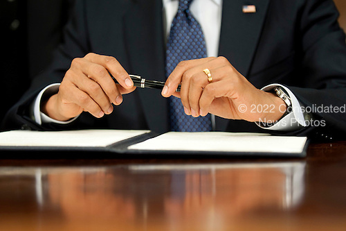 United States President Barack Obama holds his pen prior to signing a proclamation to designate Ft. Monroe, in Hampton, Virginia, a National Monument, in the Oval Office of the White House in Washington on November 1, 2011. .Credit: Kevin Dietsch / Pool via CNP