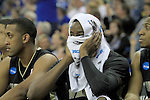 Wake Forest's sophomore forward Al-Farouq Aminu holds his head in a towel in the last few minutes of the UK men's basketball against Wake Forest for the second round of the NCAA tournament at New Orleans Arena on Saturday, March 20, 2010. The Cats won 90-60 over the Deacs. Photo by Adam Wolffbrandt | Staff