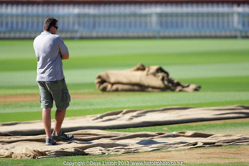 Basin Reserve turf manager Brett Sidthorpe inspects the pitch during England cricket training at Hawkins Basin Reserve, Wellington, New Zealand on Thursday, 12 March 2013. Photo: Dave Lintott / lintottphoto.co.nz